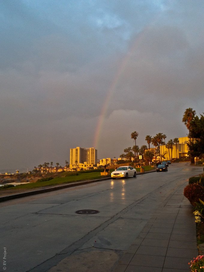 Yep, that's a rainbow coming out of the building my parents reside in. Photo by my father.