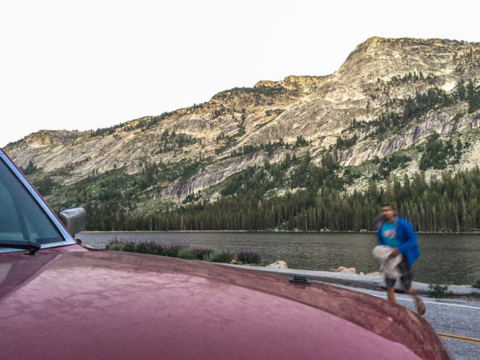 Spenser runs to the car after a post-climb sunset swim in Tenaya Lake.