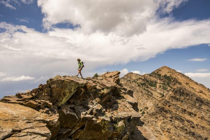 Natalie cruising through the exposure on the way to Dromedary Peak