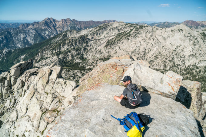 Tyson rests on the summit of Lone Peak before we beat it out of there. The red ridge in the background is what the WURL starts on.