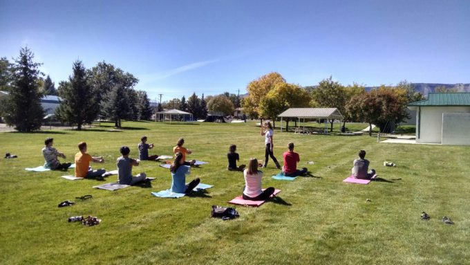 Yoga in the park led by Rebecka Cooper.